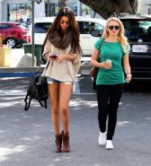 Selena Gomez leggy wearing a denim shorts  ankle boots at 'Little Cafe' in LA