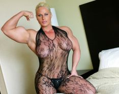 Impressive huge female bodybuilder flexing her massive muscles