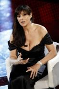 Monica Bellucci exposing her sexy body and fucking huge cleavage