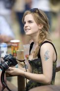 Emma Watson leggy  cleavy wearing low cut top, shorts  bots at Glastonbury Music
