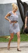 Pamela Anderson showing her wonderfull legs in mini skirt paparazzi pictures