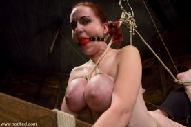 Red head Berlin with massive breasts tied up and abused hard
