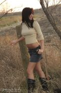 Pretty brunette stripping and posing in the wood