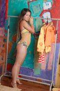 The young teen body of Emily 18 looks lovely in the yellow bikini. We see her na