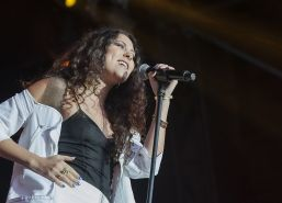Eliza Doolittle upskirt wearing white mini skirt and tiny black top at the conce