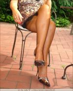 Leggy lady Barbara in brown stockings and high heels