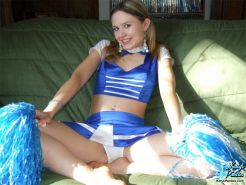Innocent teen cheerleader rips off her uniform and panties