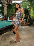 Beautiful and tan brunette spreads pussy on pool table
