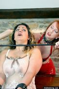 Big tits fat slave getting dominated by mistress in red latex