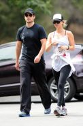 Kaley Cuoco wearing transparent tank top and tights while hiking on Hollywood Hi