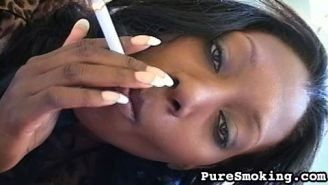 The cocoa skinned honey loves a mouth full of smoke and cock.