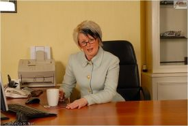 Blonde secretary Sally Taylor in womanssuit and stripe stockings