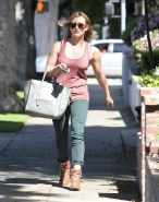 Hilary Duff wearing skimpy red top and tight jeans out in Beverly Hills