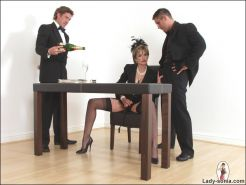 Lady Sonia in stockings and heels handjobs two subs in suit
