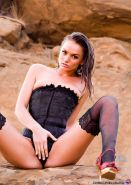 Tori Black outside and wet in a Corset and Stockings
