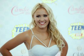 Emily Osment busty wearing white revealing dress at 2014 Teen Choice Awards in L
