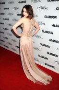 Lily Collins braless wearing a partially see-through skin colored dress at the 2