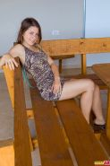 She sits at the table outdoors and Emily 18 wears a super short and tight dress