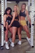 Sexy body builder ladies showing their perfect bodies in the gym