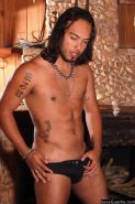 Long haired Latino gay dude poses while in the nude and looks good