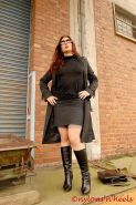 Redhead Lady Justine in stockings and boots