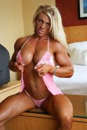 Busty sexy blonde with big ripped muscles