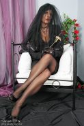 Model Eve in black pantyhose and tight corset