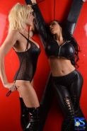 Amy Anderssen tied to a cross dominated by Puma Swede