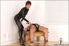 Lady sonia rubber catsuit mistress and her slave