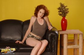 Redhead can barely hold her cigarette when she dildoing