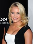 Emily Osment showing cleavage at the 'Elysium' premiere in Westwood