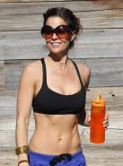 Brooke Burke busting out in sport bra and leggings while workout in Malibu