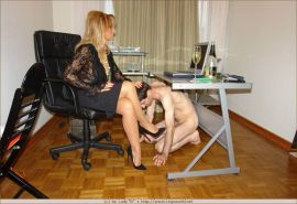 Kinky mistress in stockings playing with her foot slave