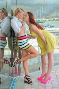 Daring girlfriends flashing and kissing on public street