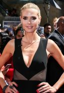 Heidi Klum showing huge cleavage at the Americas Got Talent Season 10 Red Carpet