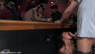 Kinky chick does blowjob act and fucked in public bondage