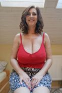 Busty amateur Cherry showing off her humongous titties