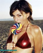 Krista Allen sucking candy and posing very sexy in bikini