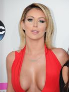 Aubrey O'Day braless wearing red low cut  high slit dress at 2013 American Music