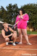 Enormous chick sitting on her tennis coaches face