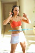 Athletic and fit girl uses her hula hoop while topless
