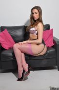 Paige Turnah shows of her nylon covered legs