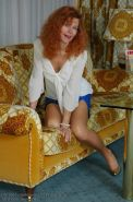 German mature redhead in stockings and heels