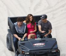Alyssa Milano upskirt wearing short tight pink dress on the film set at the beac