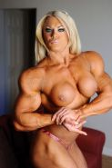 Blonde sexy muscle barbie with massive ripped muscular body