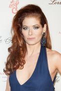 Debra Messing braless showing huge cleavage at 2013 Angel Ball in New York City