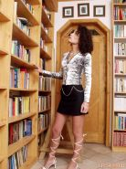Sexy librarian in her lace up heels and short skirt