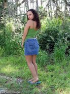 Busty frizzy hair teen girl strips outdoors