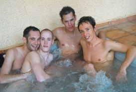 Four gorgeous twinks enjoy sucking and cumming in a warm jacuzzi