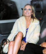 Geri Halliwell upskirt wearing a low cut purple mini dress while arriving for th
